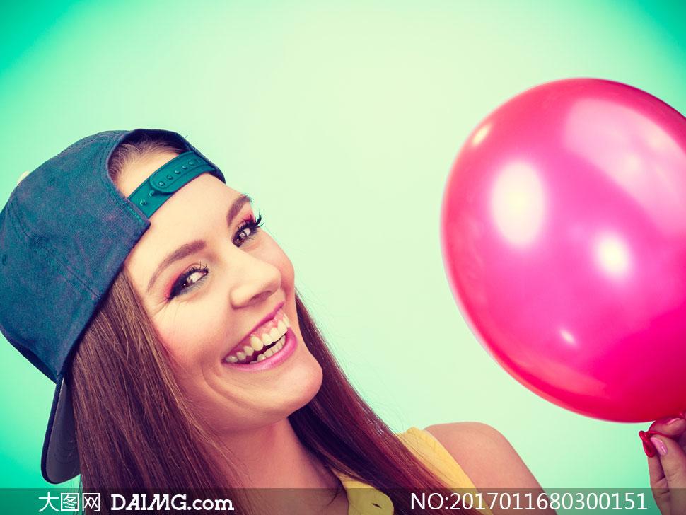 高清大图图片素材摄影人物写真模特女人女性气球近景特写笑容开心帽子