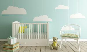 婴儿床与墙壁上的云朵图案高清图片