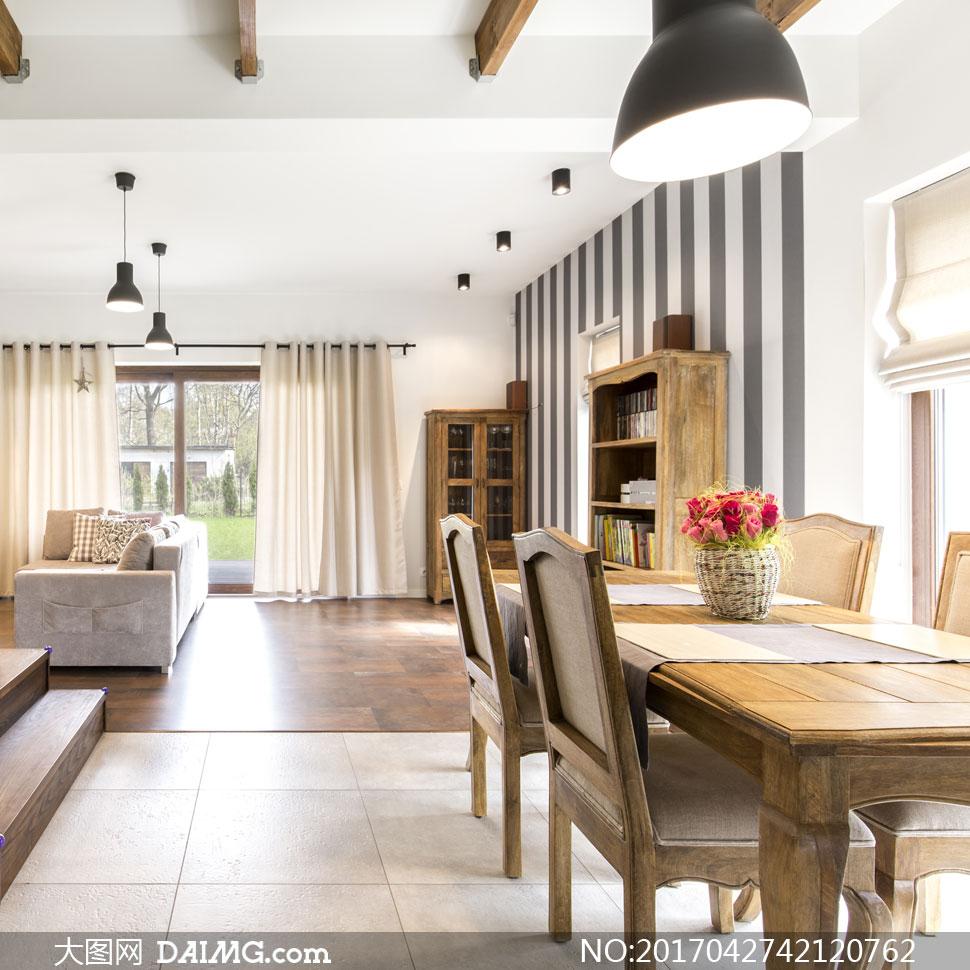 客厅沙发与餐厅桌椅摆设等高清图片