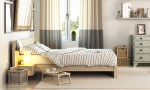 床头亮着灯的卧室房间摄影高清图片