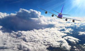 蓝天云层上飞行的飞机摄影高清图片