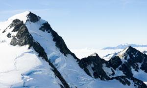 连绵起伏冰雪山峦风光摄影高清图片