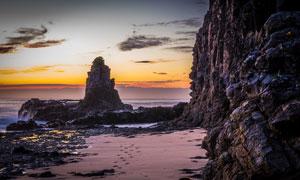 海边岩石黄昏美景摄影图片