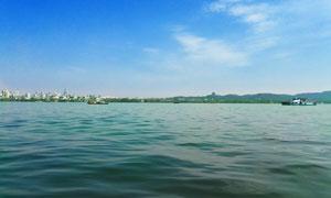 蓝天下的美丽西湖景色摄影图片