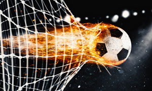 带火焰冲破球网的皮球创意高清图片