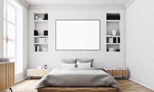 卧室大床与空白装饰画摆放高清图片