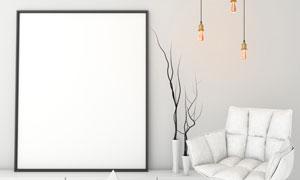干枝与收纳柜上的空白画框高清图片