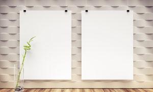 空白挂画与玻璃杯中的植物高清图片