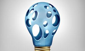 蓝色镂空效果灯泡创意设计高清图片