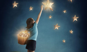 伸手去摘星星的小女孩创意高清图片