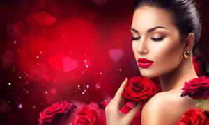 手拿玫瑰花的盘发红唇美女高清图片