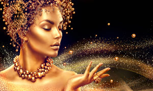 妆容美女与金色的粉屑创意高清图片