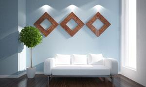客厅沙发绿植与墙上装饰品高清图片