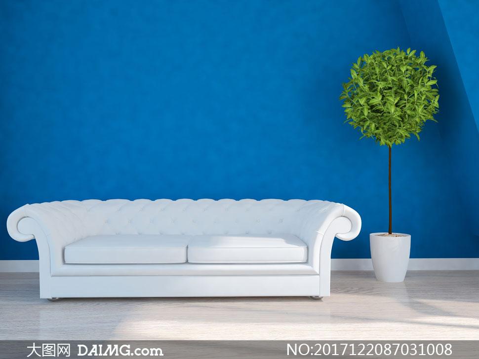 蓝色墙壁与白色的沙发设计高清图片