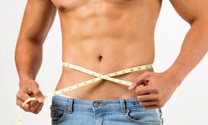 量腰围的肌肉男子局部特写高清图片