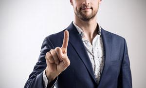 伸出手指做点击动作的人物高清图片