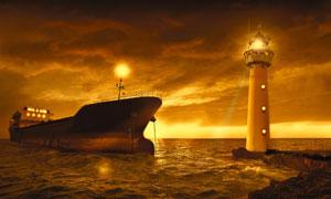灯塔与在夜航中的船只摄影高清图片