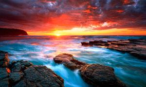 海边礁石夕阳美景高清摄影图片