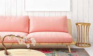 粉色沙发与木板墙上的挂画高清图片
