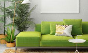 房间绿色沙发与空白装饰画高清图片