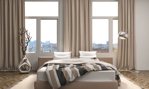 卧室摆放的双人床与落地灯高清图片