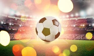 炫丽光斑与空中的足球摄影高清图片