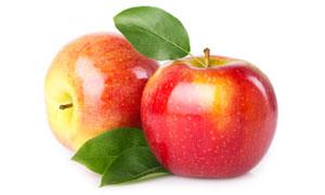 带着绿叶的红苹果特写摄影高清图片
