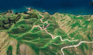 海边山丘上的蜿蜒小路摄影高清图片