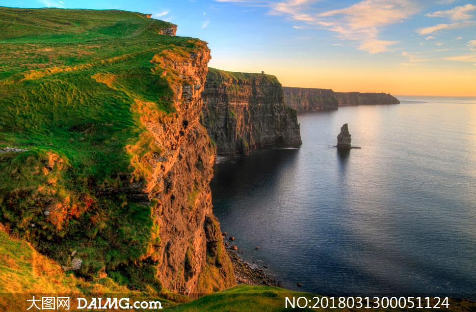 海边悬崖黄昏美景摄影图片