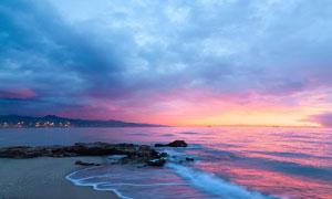 海边岩石夕阳暮色美景摄影图片