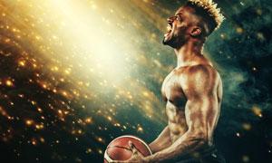 耀眼光效下的健壮篮球男子高清图片