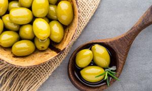 色泽莹润橄榄制品特写摄影高清图片