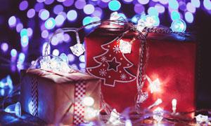 灯光与光斑元素点缀的礼物高清图片
