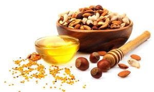 蜂蜜与混合坚果仁特写摄影高清图片
