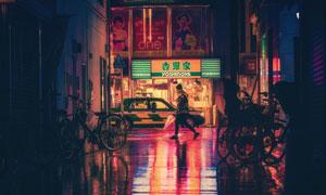 夜晚在街上行色匆匆的美女高清图片