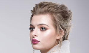 盘发妆容美女人物侧面摄影高清图片