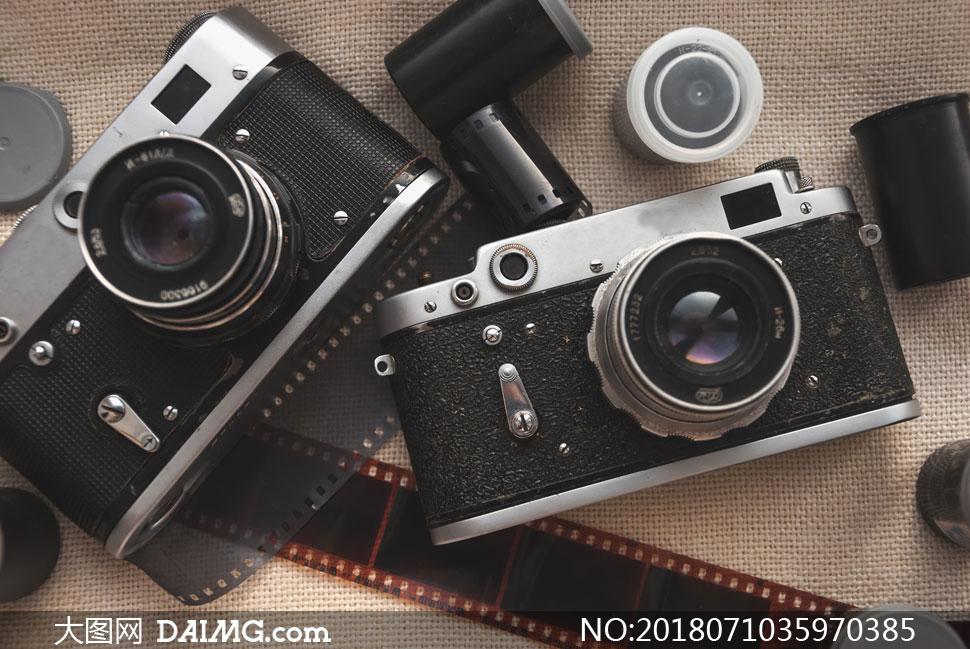 胶卷与照相机镜头特写摄影高清图片