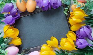 绿叶鲜花与彩蛋组成的边框高清图片