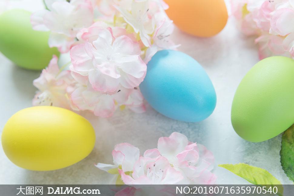 复活节彩蛋与粉色鲜花摄影高清图片
