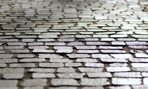 光照下的铺砖地面特写摄影高清图片