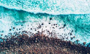 海水与海边的砾石鸟瞰摄影高清图片