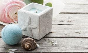贝壳花瓣与蜡烛等物品摄影高清图片