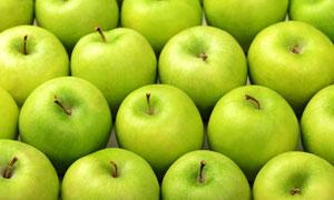 紧挨着排列的青色苹果摄影高清图片