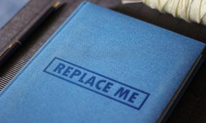 蓝色布纹记事本上的标志贴图源文件