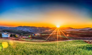 夕陽下的美麗拉薩高清攝影圖片