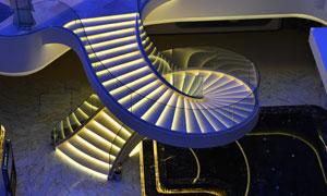 絢麗光效裝飾的螺旋式樓梯高清圖片
