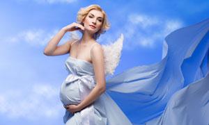 天使翅膀裝扮孕婦寫真攝影高清圖片