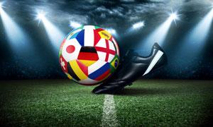聚光灯下的足球与球鞋创意摄影图片