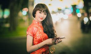 穿紅色旗袍的黑發美女攝影高清圖片