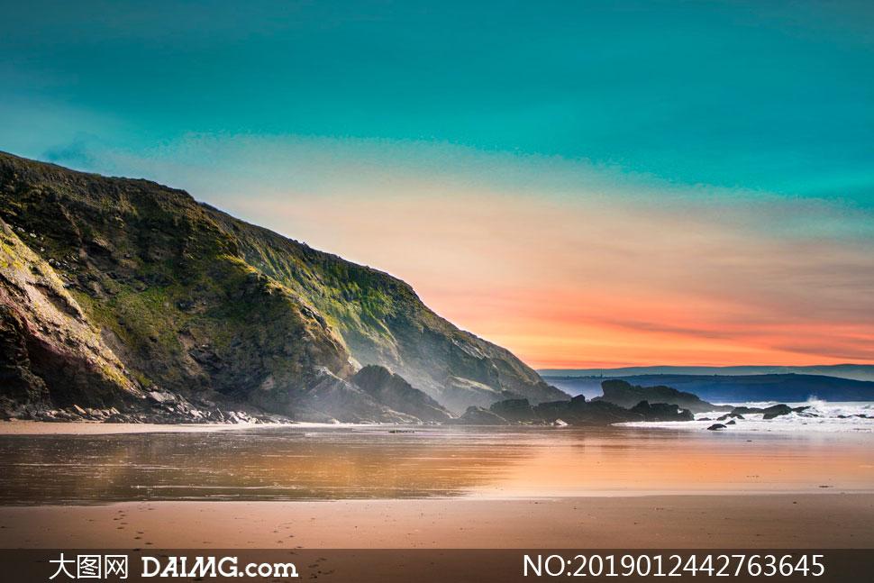 大海岸边岩石晚霞风光摄影高清图片